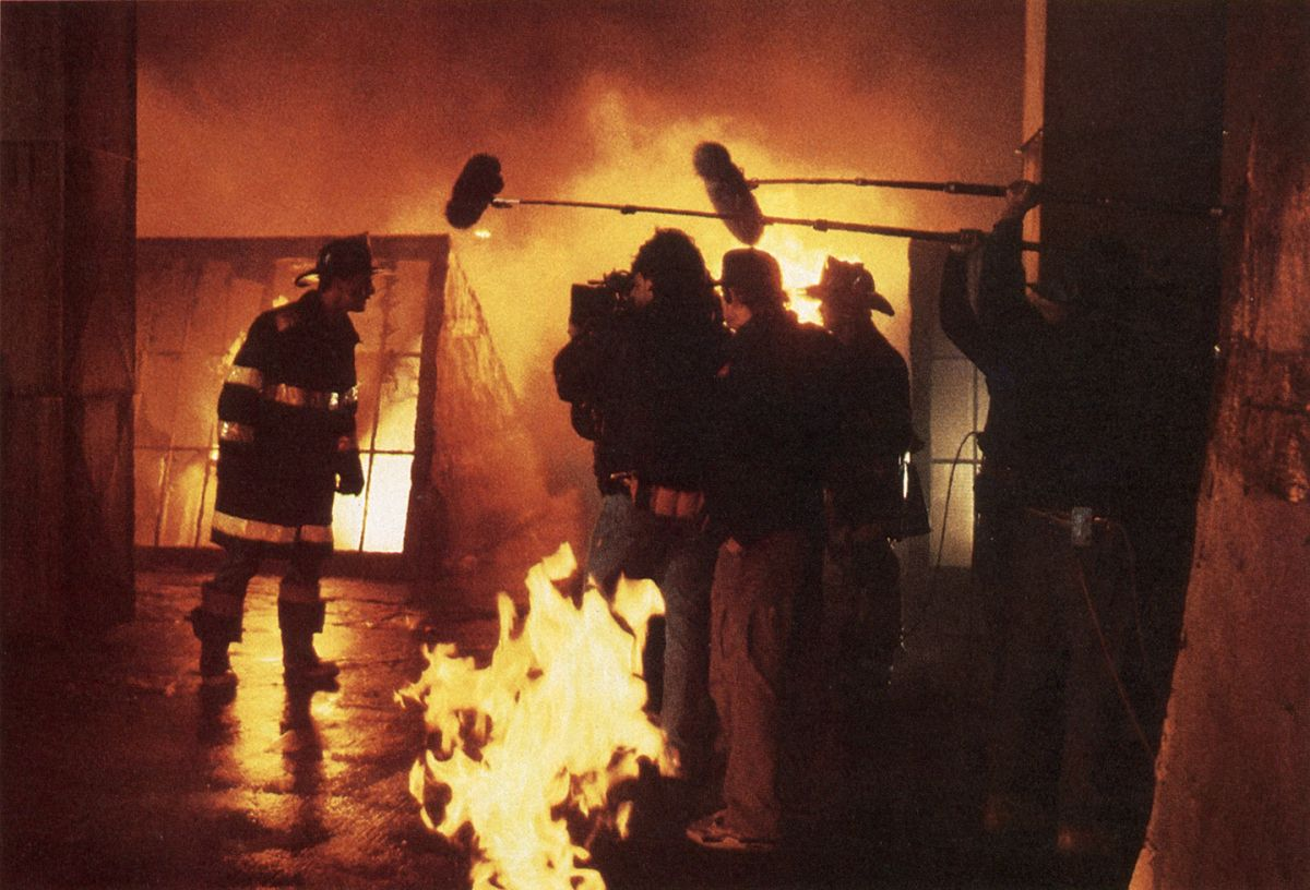 Salomon's crew sets up on actor Billy Baldwin while shooting Backdraft (1991). (Photo from the AC Archives.)
