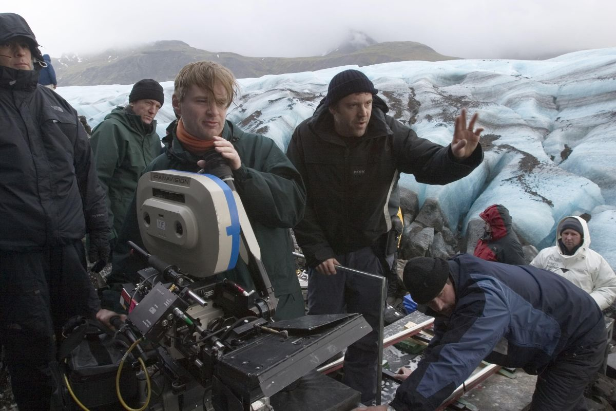 Shooting Batman Begins (2005), director Christopher Nolan (left) and cinematographer Wally Pfister, ASC (right) set up on a glacier.