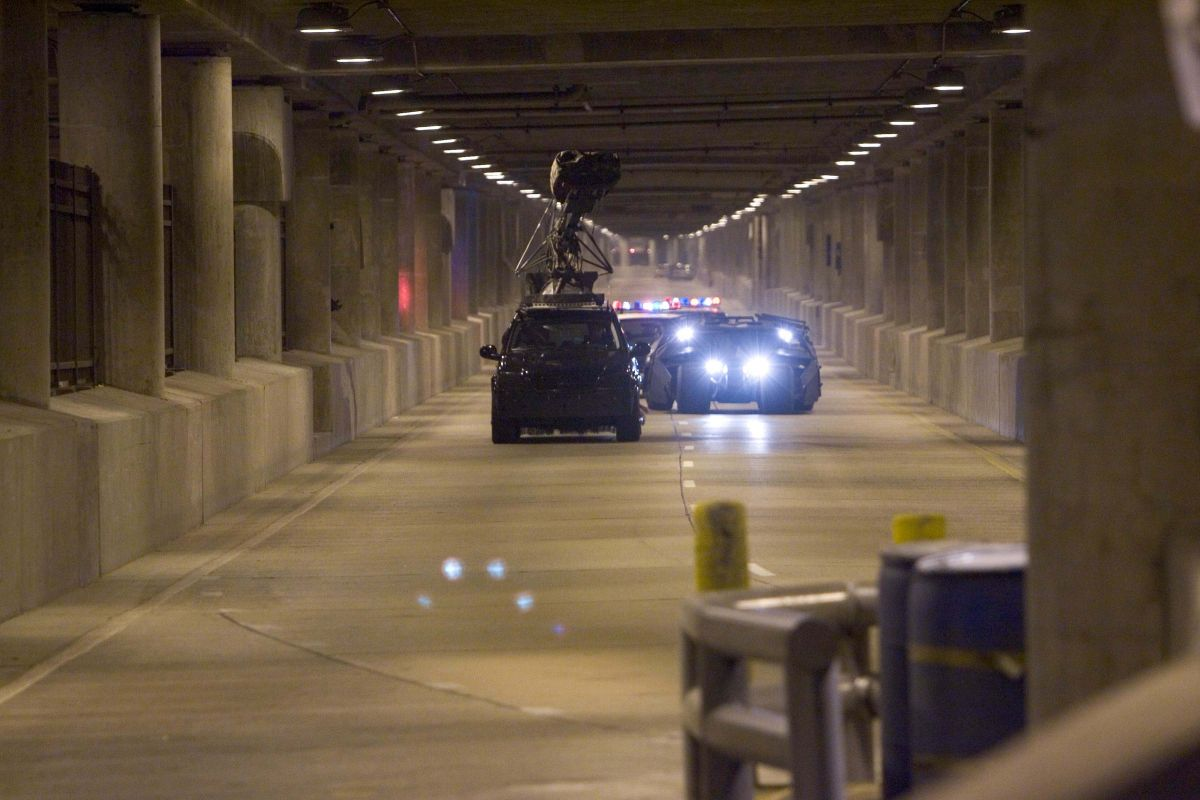 A tracking vehicle captures some driving action in the tunnel of Chicago's Lower Wacker Drive. Existing fixtures provided much of the illumination, but U.S. gaffer Cory Geryak and his crew augmented light in areas where stunts would take place.