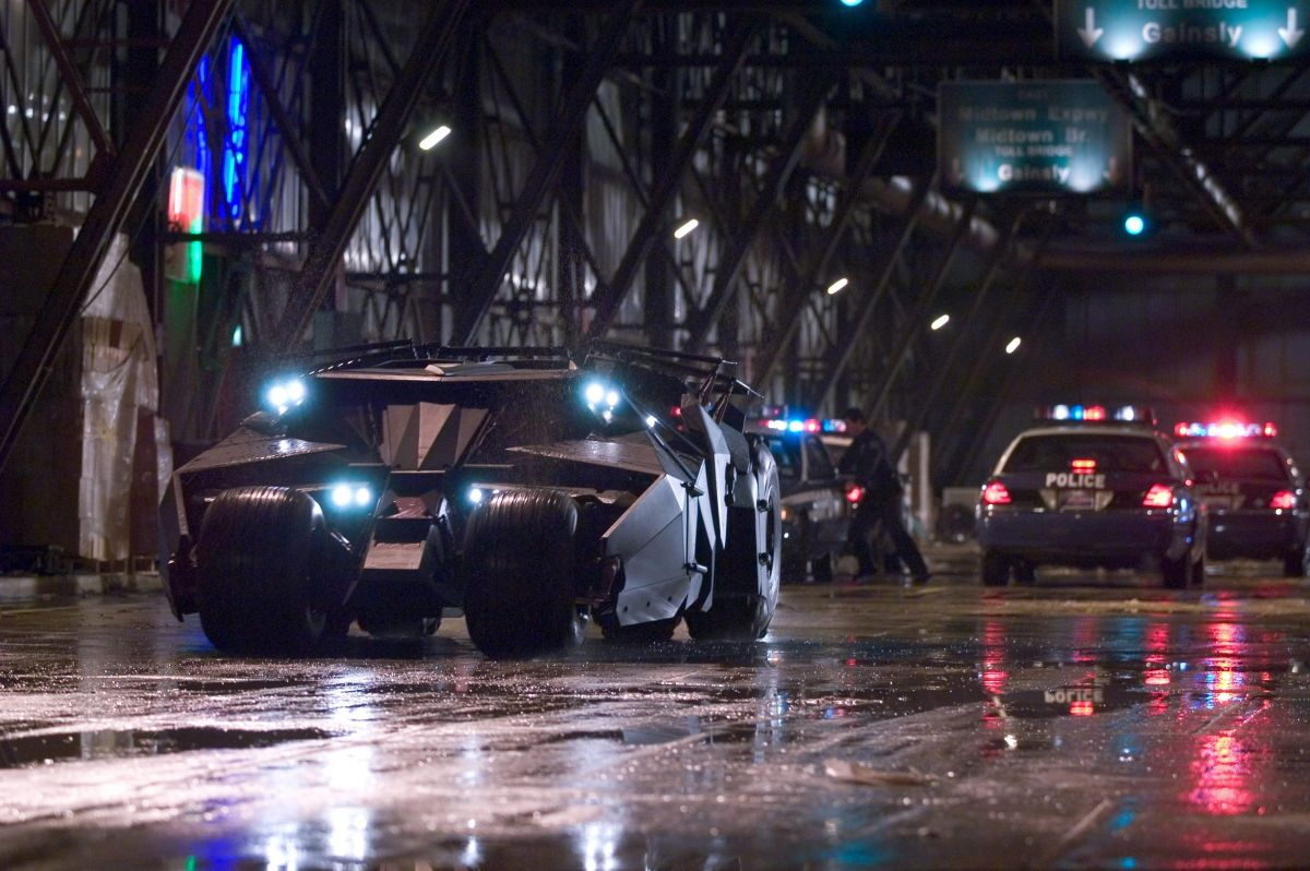 "The Batmobile attempts to elude police pursuit during the film's climactic chase. ""It was very important to me how the car was lit,"" Pfister says. ""In designing the car together, Nathan and Chris came up with a very clever pattern of lights for the headlight arrangement. I love the way those lights look; they're very tiny, pinpoint sources that are very bright."""