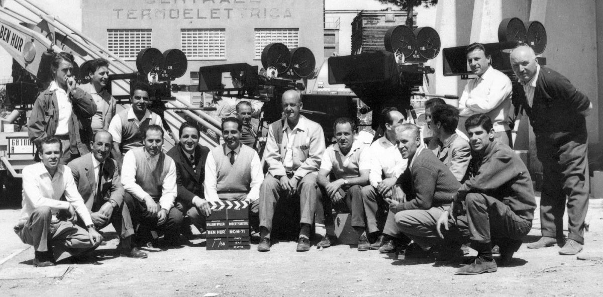 At center, cinematographer Robert Surtees, ASC is surrounded by his camera team on the Cinecitta Studio lot in Rome. Ultra Panavision optics create a mild 1.25 anamorphic squeeze of the 2.2:1 image area, resulting in an ultra-wide 2.76:1 aspect ratio on the screen.