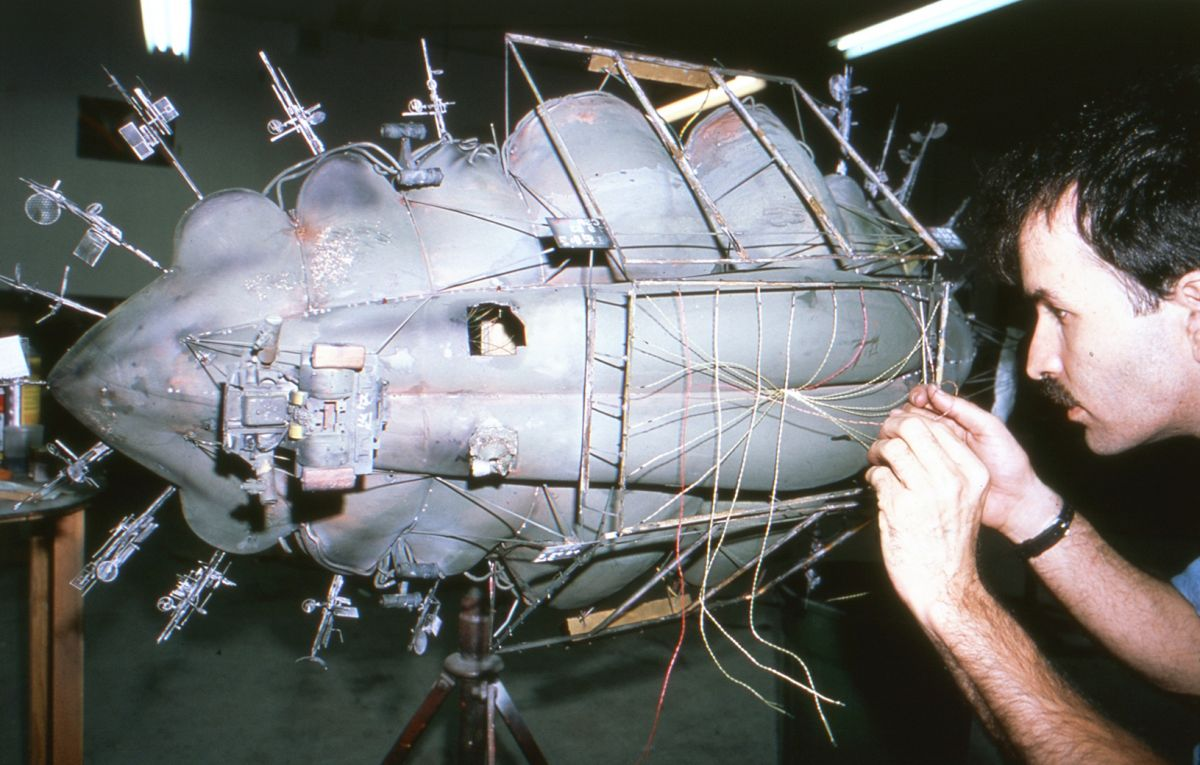 Michael McMillen works on the Blimp model, which is only briefly glimpsed in the film.