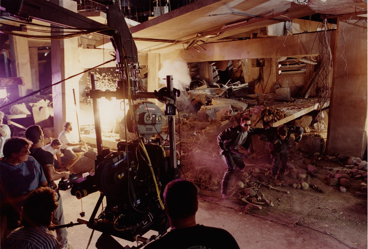 A 3D sequel of sorts to Cameron's Terminator 2: Judgment Day (1991) — shot by Adam Greenberg, ASC — the ride film T2 3-D: Battle Across Time (1996) was created for an attraction at Universal Studios' theme parks. Following True Lies, Cameron brought Carpenter in to shoot the unique project, which was photographed in 3D with twin 35mm cameras mounted together, as seen in this shot featuring the crew lining up on the Terminator himself, Arnold Schwarzenegger.