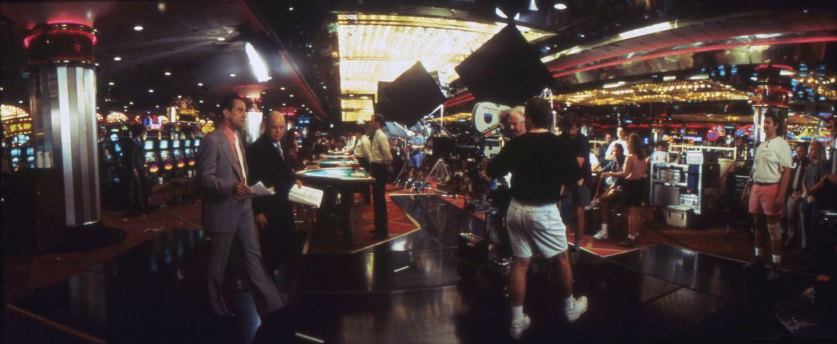 The crew sets up in the Riviera. To better control lighting in the gaming areas, extra bulbs and chrome-plated Par cans were added to existing overhead lighting bays, and the entire setup was controlled through a dimmer board. For wide shots of the casino floor, Richardson aimed Dinos and Maxis through muslin. The cinematographer also made extensive use of cutters to keep the reflective glare out of his lens.