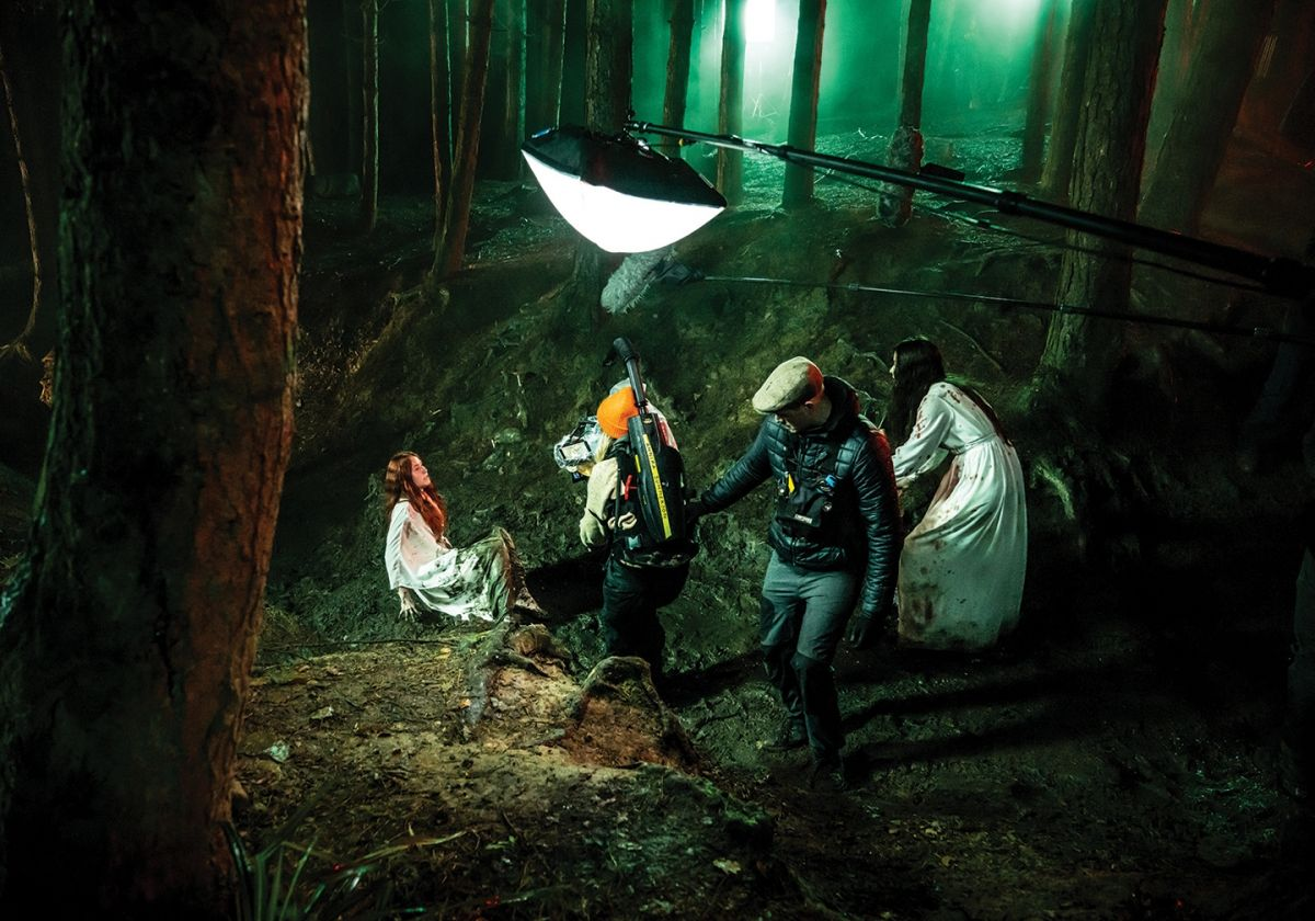 Summerson (orange cap) captures part of the forest sequence.