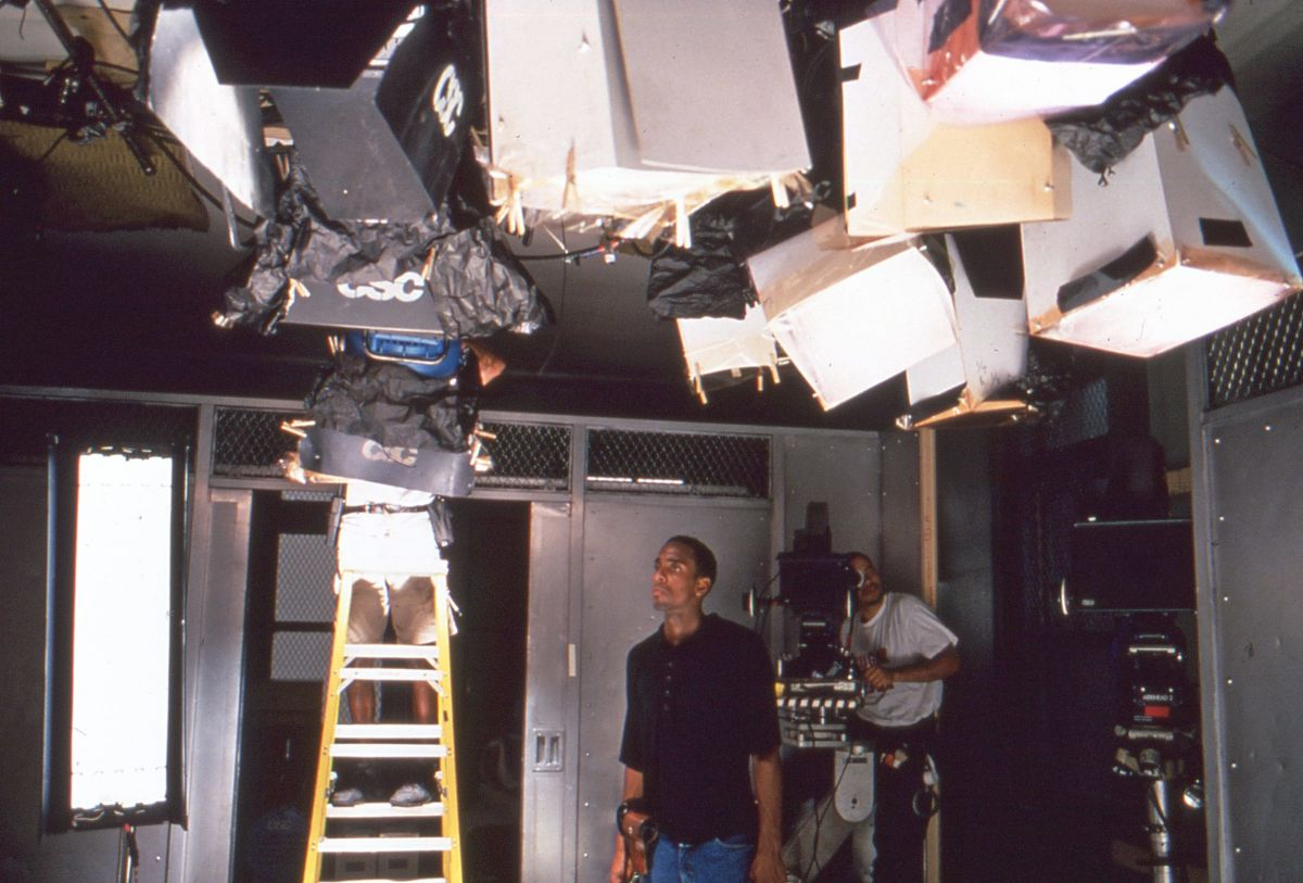 For an interrogation scene involving a young boy (Pee Wee Love) and his mother Iris Jeeter (Regina Taylor), Sayeed sought inspiration from Robert Richardson's approach to similar scenes in the Oliver Stone film JFK. A combination of ceiling-mounted HMIs and floor-mounted Kinoflos, in conjunction with Kodak's unusual 5239 film stock and a reflective board on the table, helped to create a hot, glowing aura around the actors. (Seen below.)