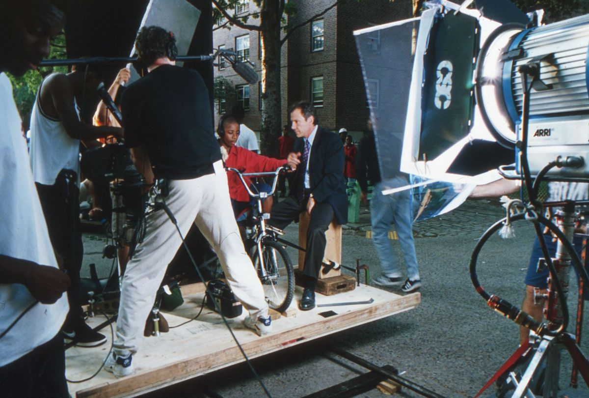 To create a surrealistic flashback scene in which Detective Klein floats along behind a boy's bicycle, the filmmakers placed the camera and the actors on a plywood sled. Mounted on lengths of black pipe, the sled was pushed past the location background to create the otherworldly effect seen in the finished frame. (Seen below.)