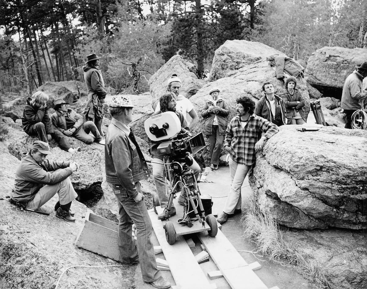 Director Steven Spielberg (reclining in hat at upper left), cinematographer and Society member Vilmos Zsigmond (at camera), and the crew of Close Encounters of the Third Kind on location. Zsigmond earned an Academy Award for his work on the picture.