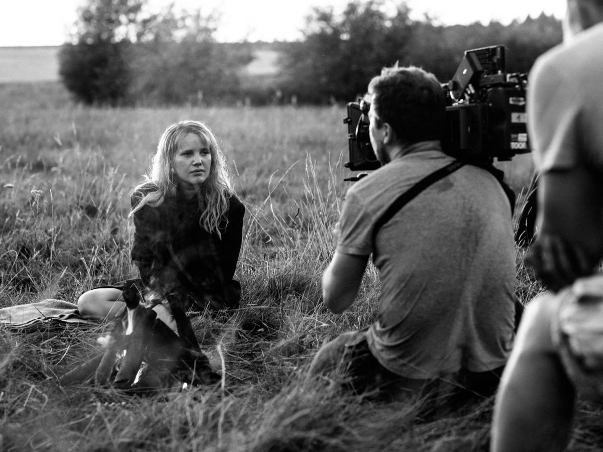 """A day exterior with Kulig is captured with a handheld Arri Alexa XT. Like Ida, Cold War was shot in color and desaturated to black-and-white in post. Also as with Ida, the lighting, production design, costumes and background were designed for monochrome. Video village monitored the shoot in black-and-white. """"I couldn't think of a color that would make sense,"""" Pawlikowski says of the feature's black-and-white imperative. """"There was no color in Poland in the 1940s and Fifties. It was all gray, brown and greenish. We played with the notion of shooting the picture [in a way that would approximate] the East German/Soviet stock Orwo, with its washed-out greens and reds, but I felt it would seem too mannered."""""""