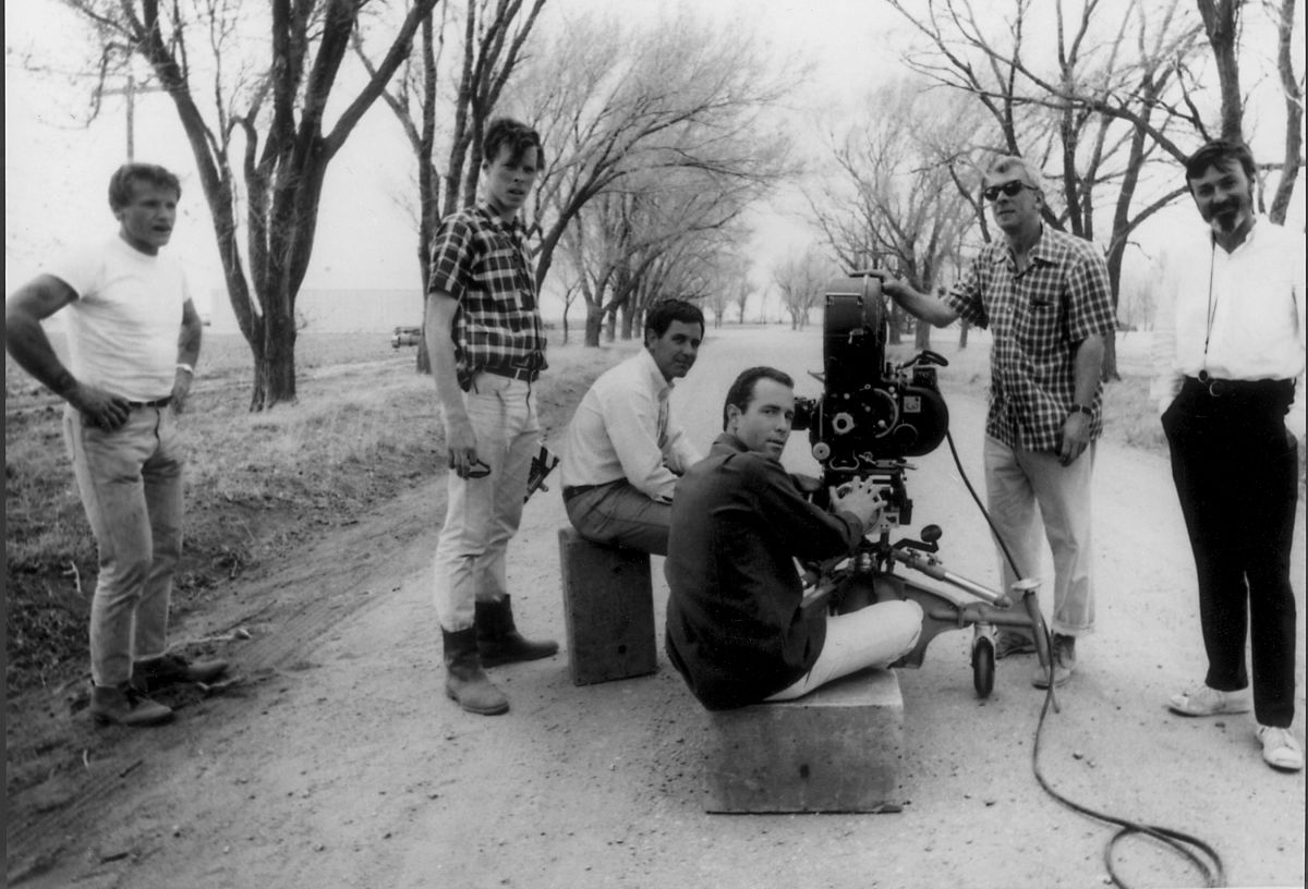 Assistant cameraman Bobby Thomas, operator Jordan Cronenweth, director Richard Brooks and Hall line up a shot for In Cold Blood (1967).