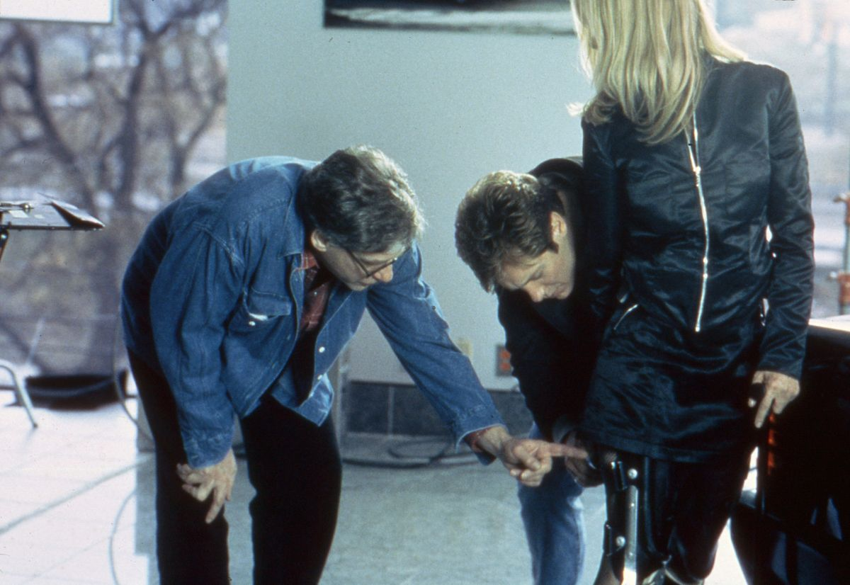 Cronenberg and Spader check the braces on Rosanna Arquette's Gabrielle.