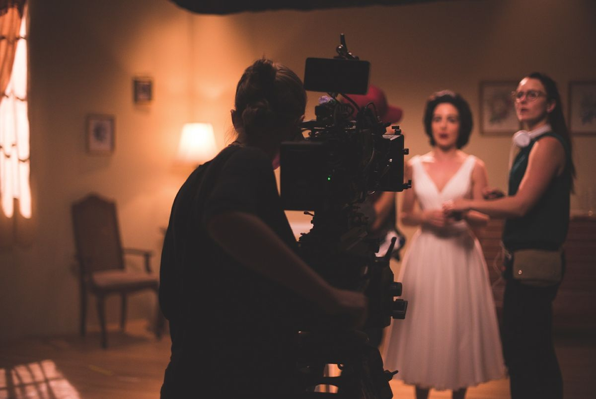 Cinematographer Katharine White at the camera while director Foster Wilson confers with Grace Kendall.