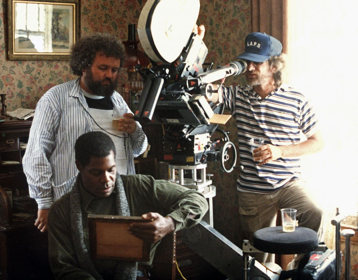 Daviau and director Steven Spielberg (at eyepiece) line up a shot over actor Danny Glover.