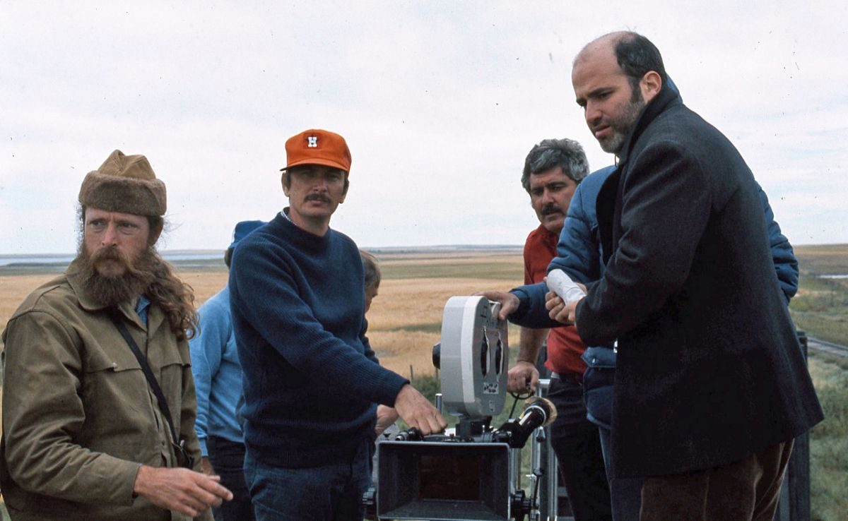 Camera operator John Bailey (second from left) and the rest of the camera crew set up a shot under the watchful eye of writer-director Terrence Malick (far right).
