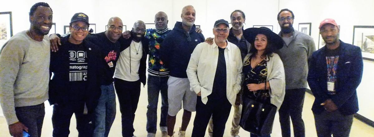 Simmons (in white jacket) with friends and guests at the museum, including cinematographer Hans Charles, camera operator and cinematographer Quenelle Jones, cinematographer Dennis Flippin, cinematographer Michelle Clementine, cinematographer Daniel Patterson, cinematographer Tommy Maddox-Upshaw and cinematographer Yves Wilson.