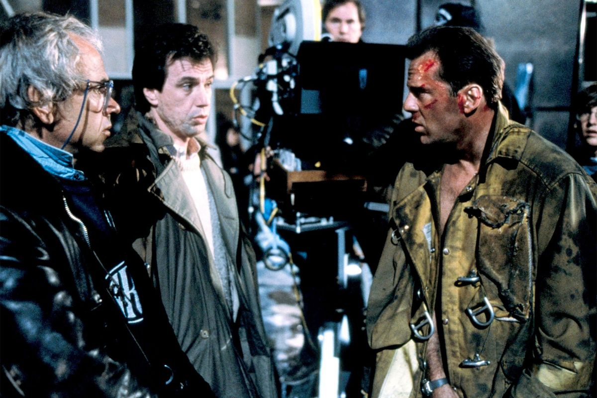 From left, Jan de Bont, ASC, director John McTiernan and Willis confer between shots.