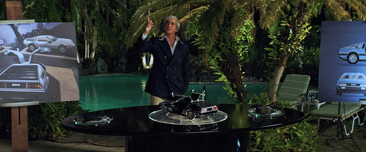 DeLorean makes a presentation during a party at his home.