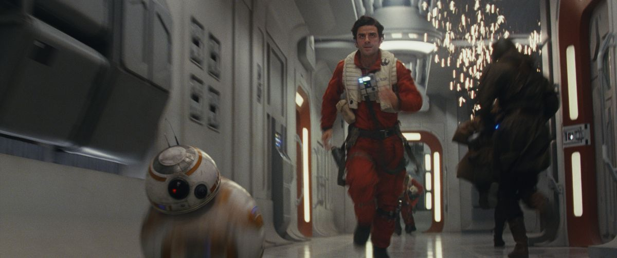Resistance pilot Poe Dameron (Oscar Isaac) and his faithful droid BB-8 make haste aboard the Resistance command ship.