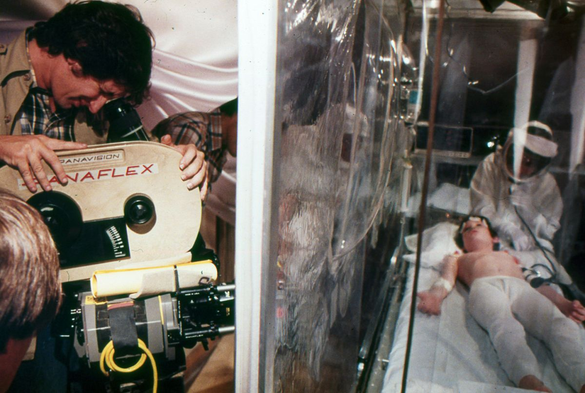 Spielberg checks the frame while setting a shot on Thomas in the medical tent.
