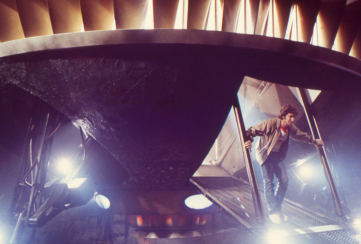 Spielberg steps out of ET's spacecraft on stage at Culver Studios.
