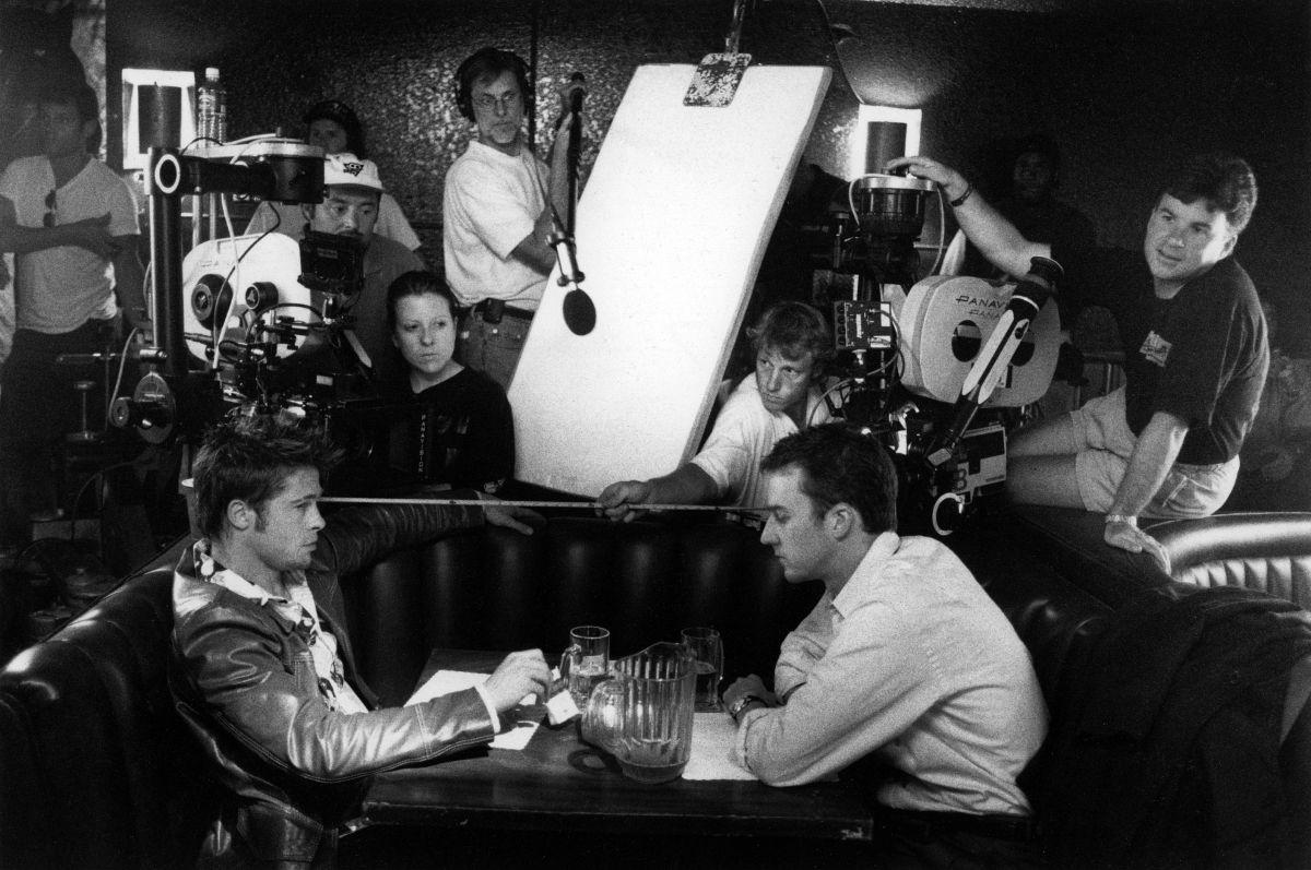 Cronenweth (wearing cap, just behind the camera on left) and his crew set up double coverage for a conversation scene between Tyler Durden (Brad Pitt) and the film's nameless narrator (Edward Norton).