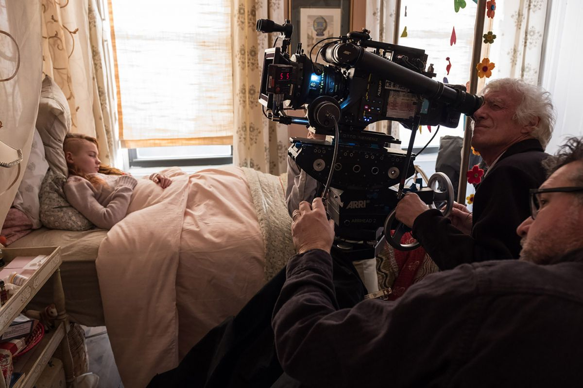 On location in Brooklyn, N.Y., Roger Deakins, ASC, BSC and 1st AC Andy Harris capture Theo's visit to Pippa (Aimee Laurence, left), another young survivor of the bombing.