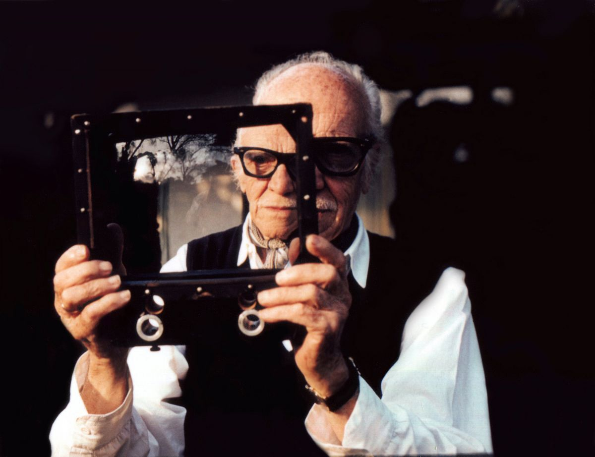 Figueroa photographed in his home in 1991. He's holding a gift from director John Ford: a diminishing glass used to convert a 25mm lens to 20mm for shooting landscapes. (Photo by the author, Tom Dey)