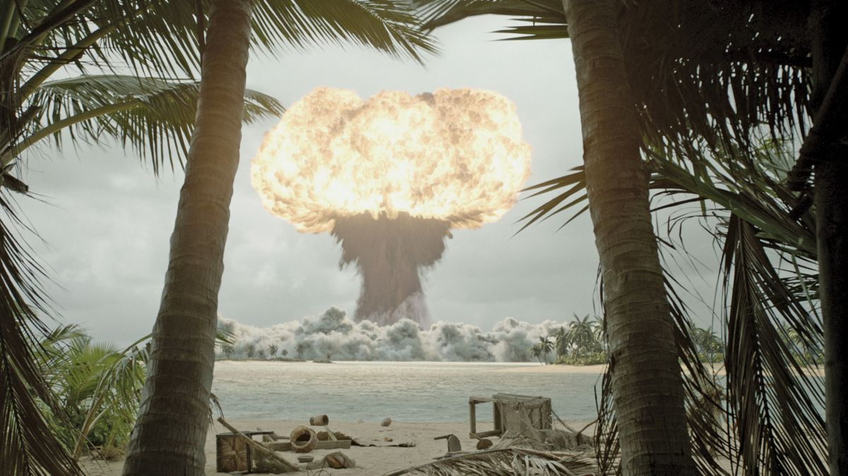 In the movie's plot, the 1950s atomic blast on Bikini Atoll was no mere test, but the U.S. military's fruitless attempt to kill dangerous creatures. Compositions such as these, constructed in-depth with recognizable elements in the foreground, help establish the film's epic scale.
