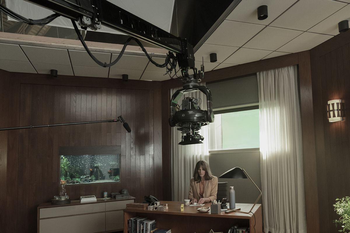 The camera is craned into position for a high-angle shot above Bergman's desk.