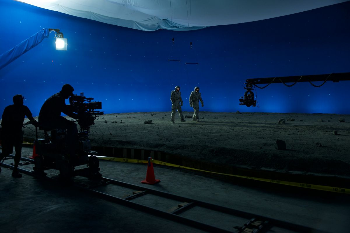 The crew shoots a scene in which Levinson and Morrison walk on the moon.