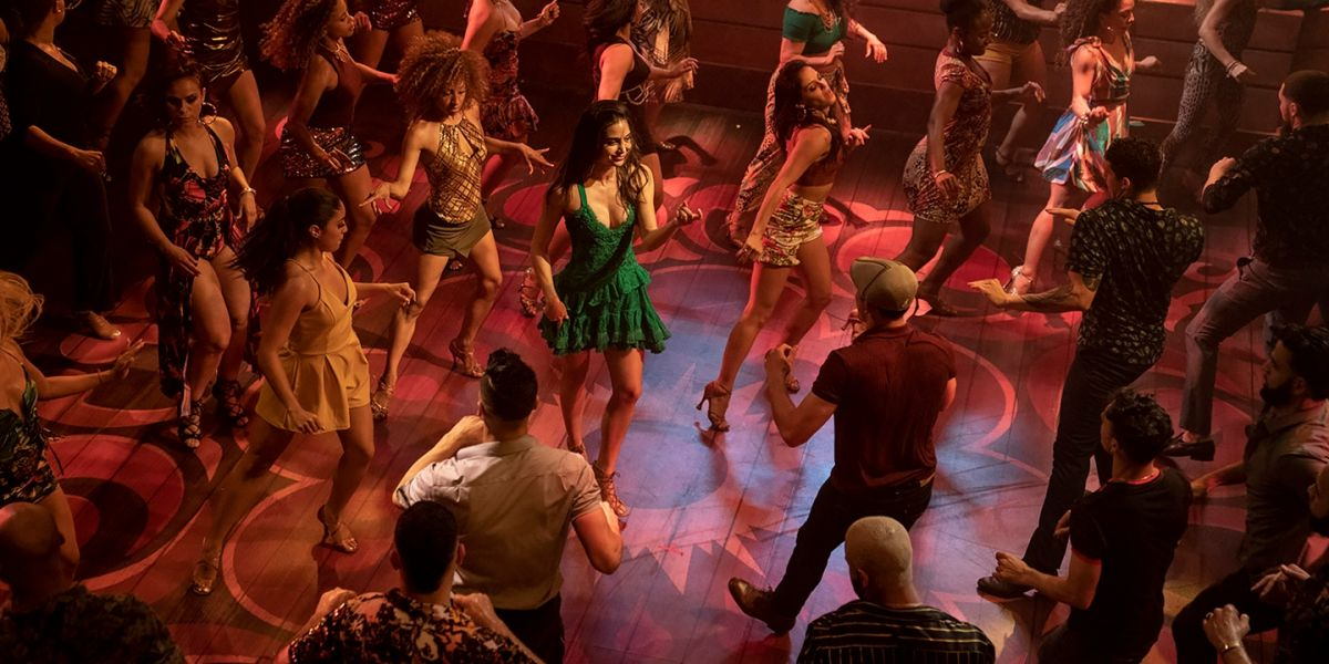 Vanessa tries to entice Usnavi to join her on the dance floor of a nightclub.