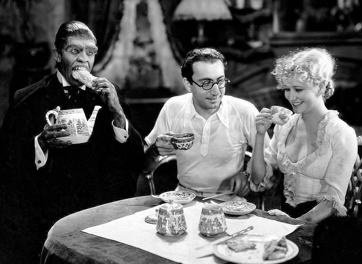 March, director Rouben Mamoulian and actress Miriam Hopkins take tea in a promotional shot from the set.