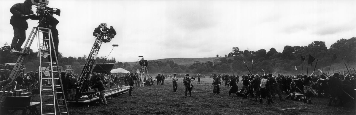 Using multiple camera setups, Toll prepares to shoot a scene depicting the Battle of Falkirk during the filming of the period epic Braveheart (1995), directed by and starring Mel Gibson. His work earned the cinematographer his second consecutive Oscar and the ASC Award.