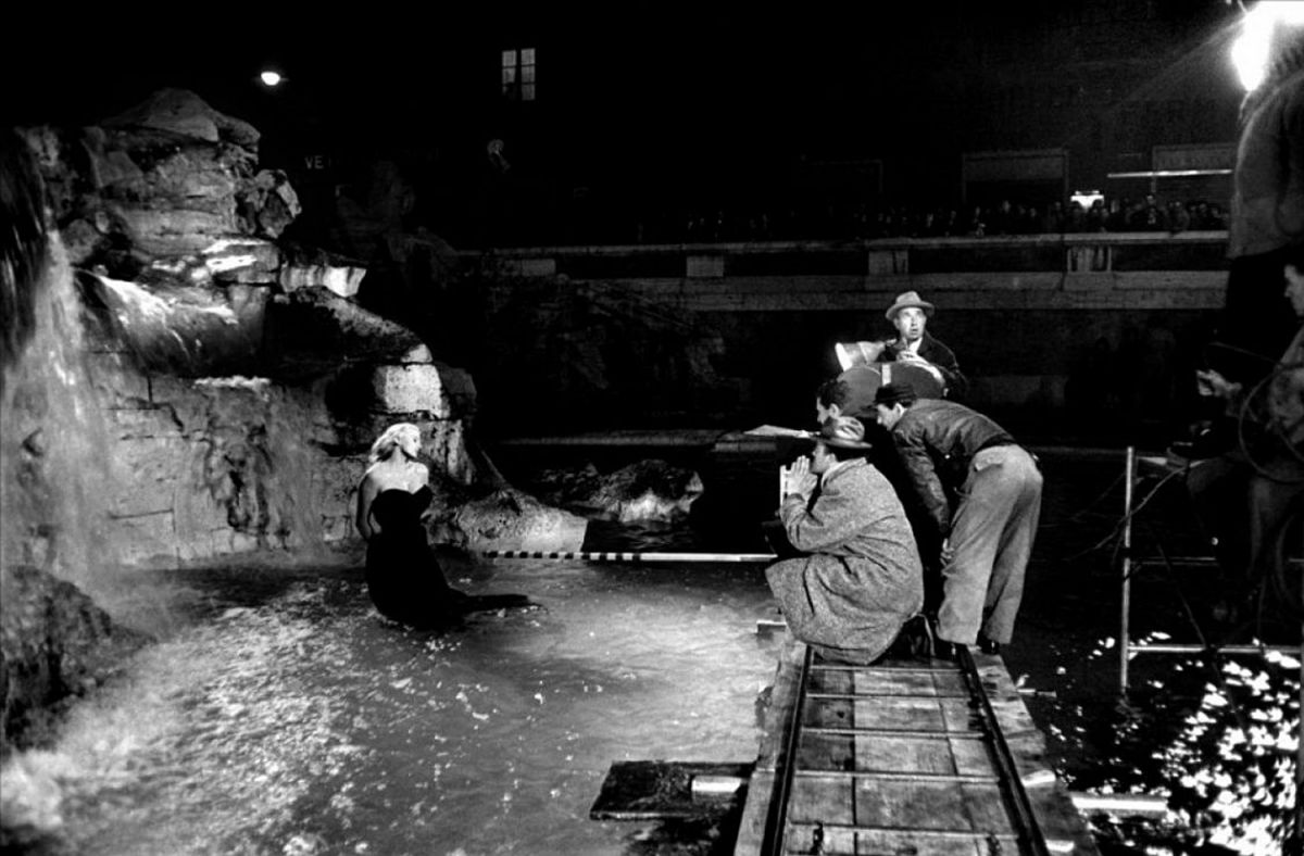 Director Federico Fellini and his crew, including cinematographer Otello Martelli, shooting the famed sequence at the Trevi Fountain in Rome.