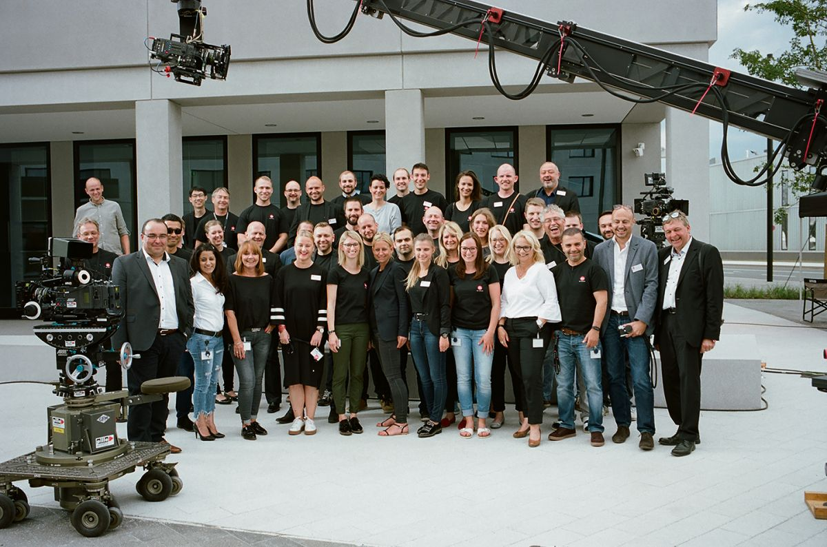 Leica executives and employees assemble in front of the Ernst Leitz Wetzlar building. (Photo by James Hills)