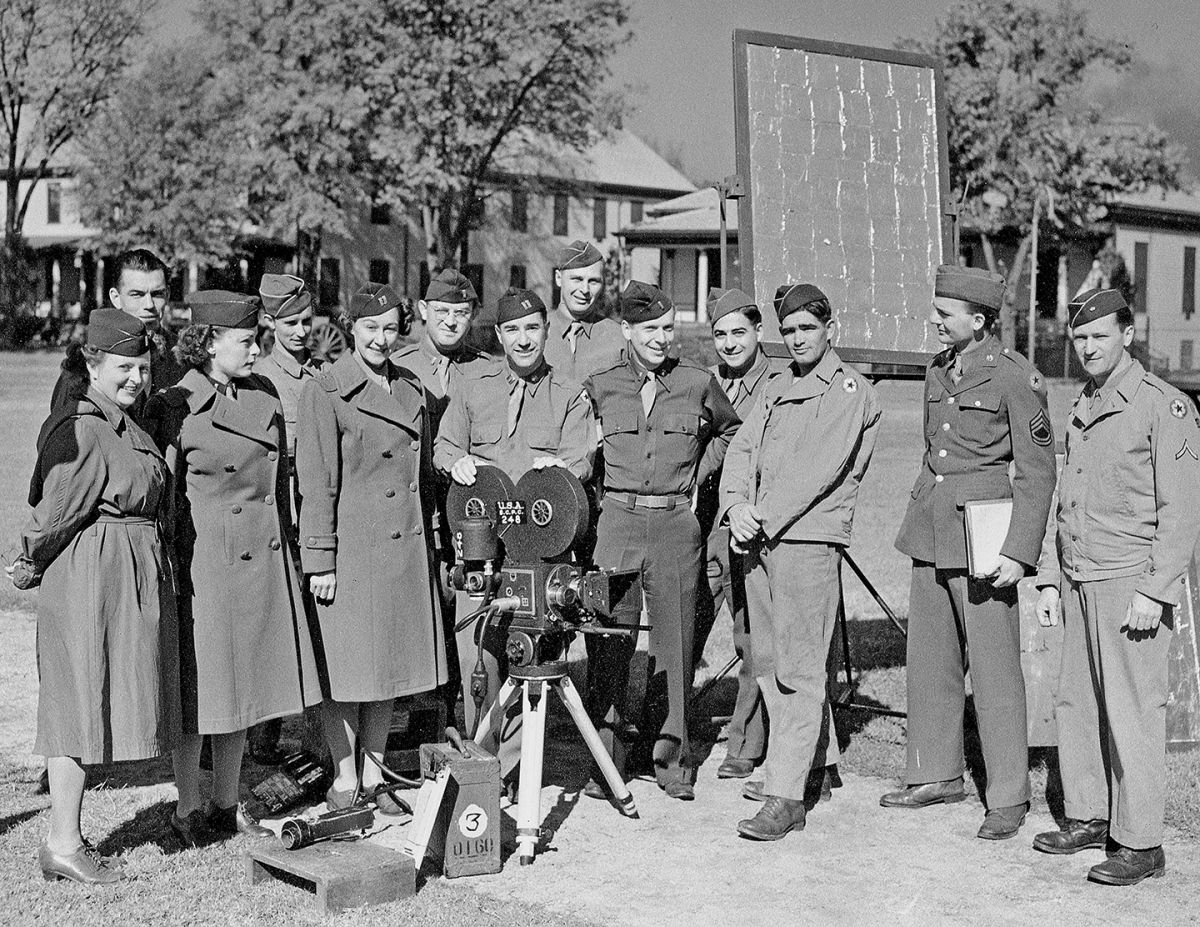 At center is Leo Tover, ASC at Ft. Oglethorpe with members of his photographic unit, including future ASC member Gerald Hirschfeld (fourth from right, in back).