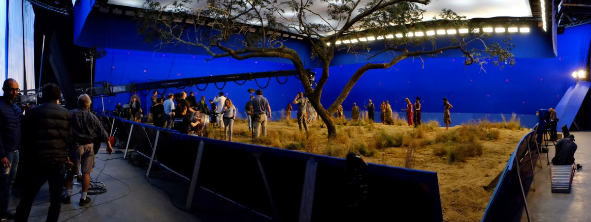 "Working on a stage in Atlanta, the cast and crew ready a bluescreen-surrounded African ""exterior."""
