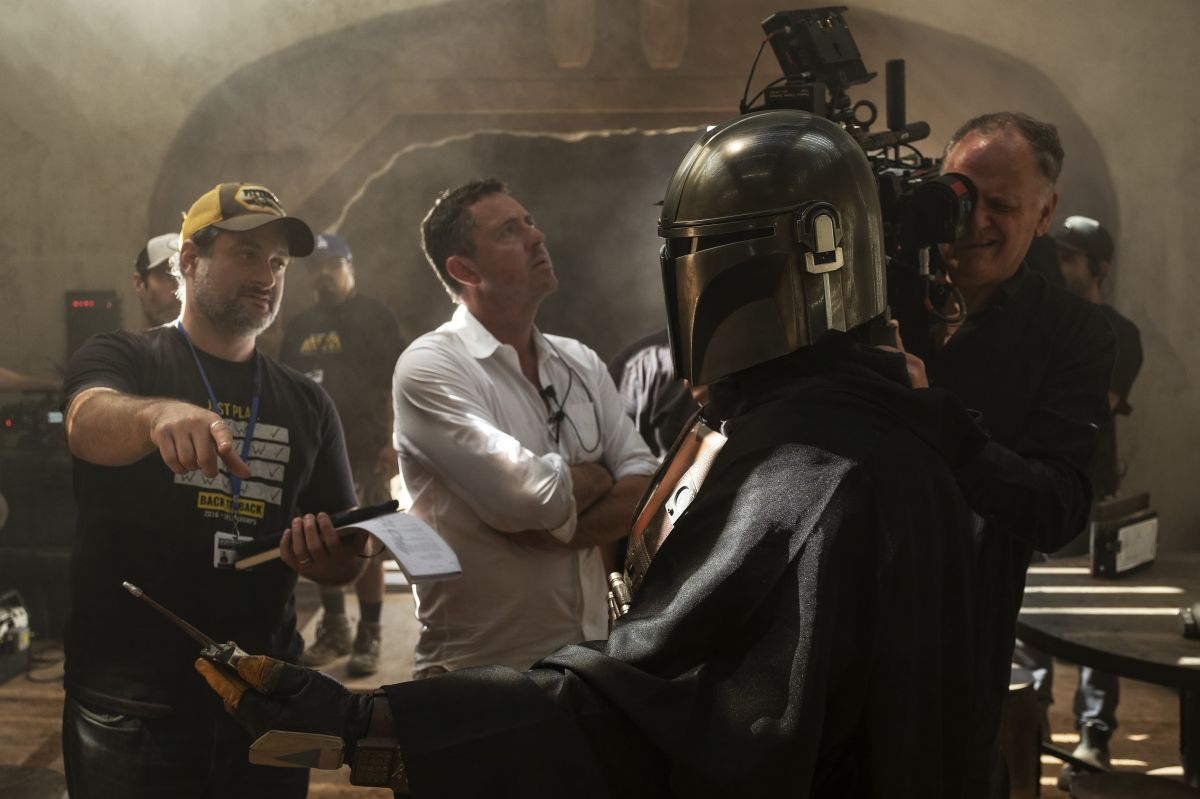 "Director and executive producer Dave Filoni and cinematographers Greig Fraser, ASC, ACS (center) and Barry ""Baz"" Idoine (operating camera) on the set."