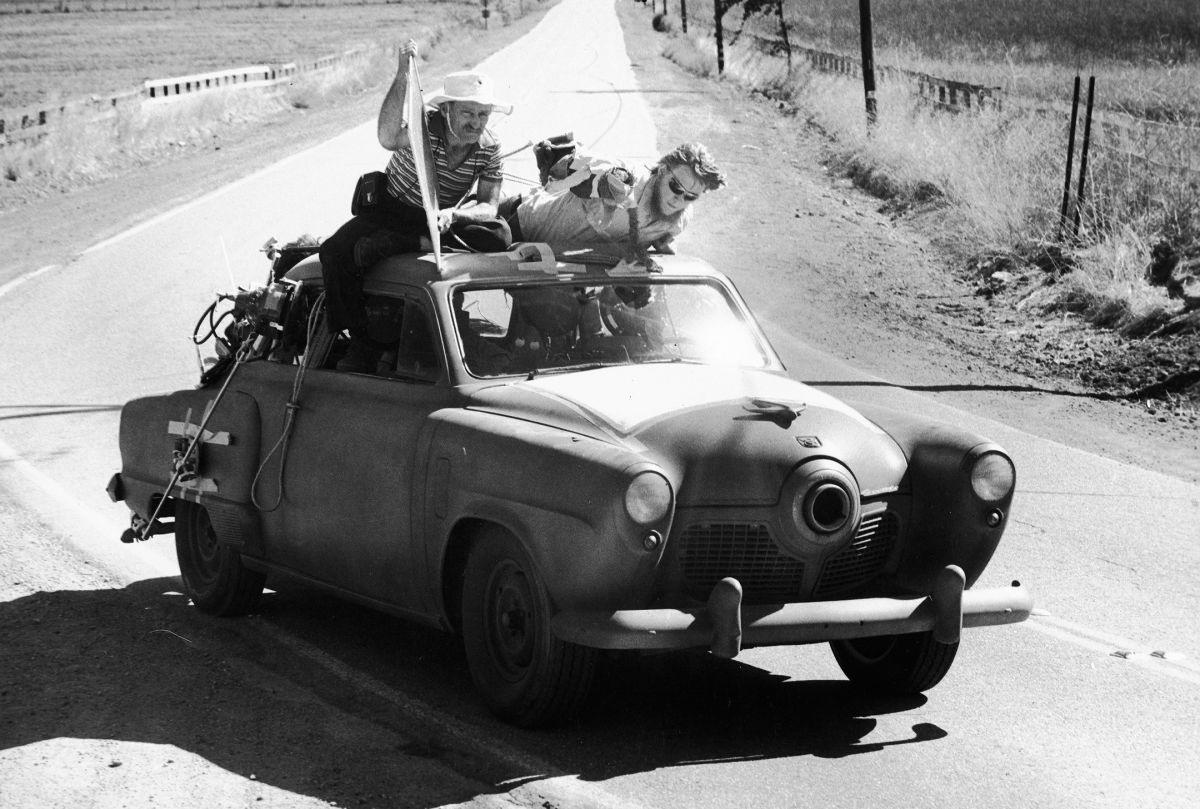 "Shooting The Muppet Movie (1979): Holding a flag, Mankofsky helps shape his lighting on ""Gonzo the Great"" from the top of a Studebaker. The camera is in the back seat, facing the windshield."