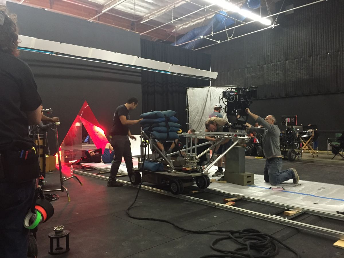 At Calvert Studios, Refn takes five under the inverted pyramid of mirrors as the crew sets up.