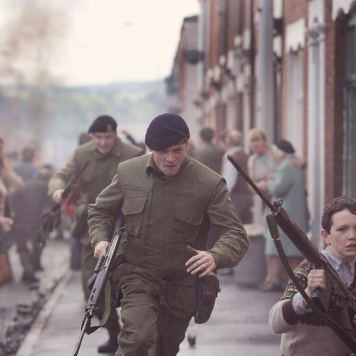 Pvt. Hook (Jack O'Connell) and his fellow soldiers scramble as a riot erupts in a Belfast neighborhood.