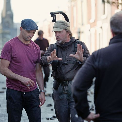 Director Yann Demange (left) and cinematographer Tat Radcliffe confer on set. The production used four cities in northern England to recreate period Belfast locations.