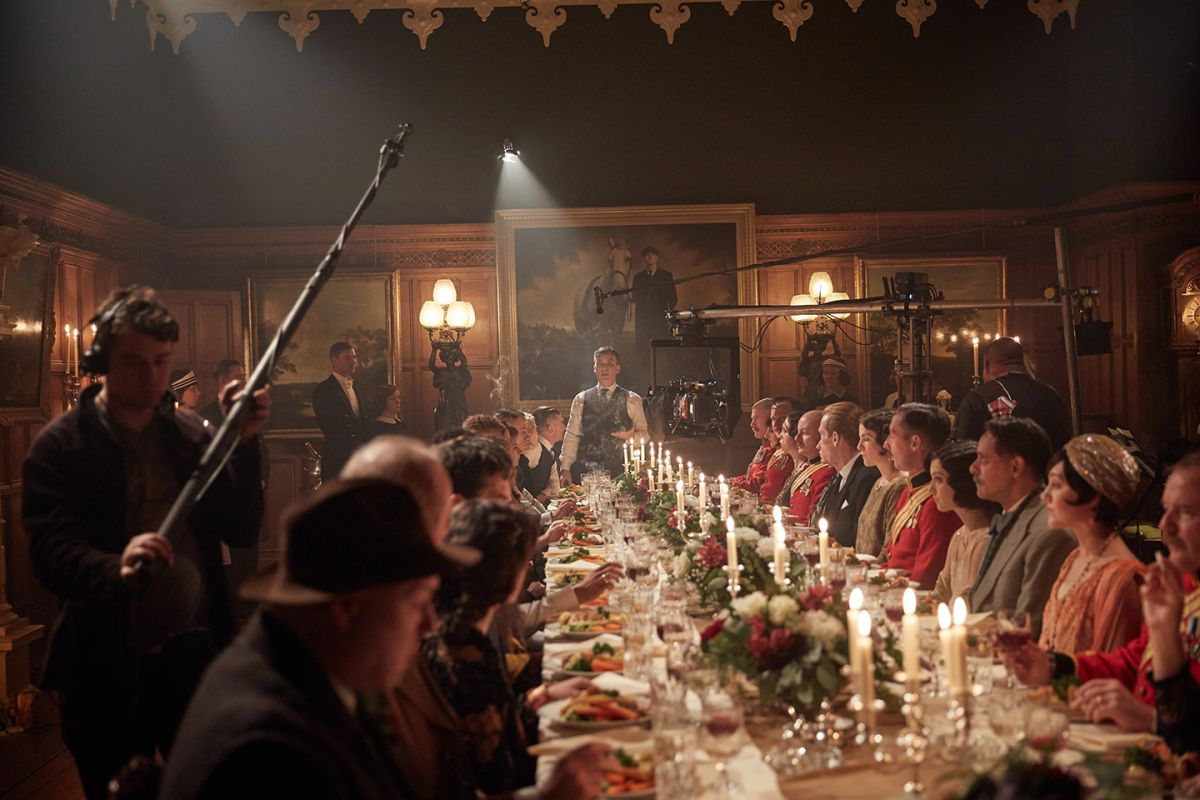 Cast and crew ready a lavish dinner scene.