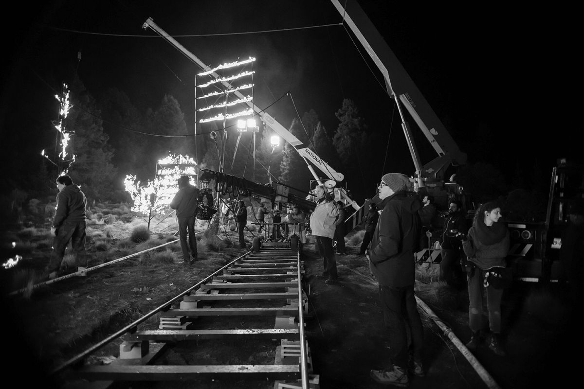 Inspectors restricted them from using fire in the background near real trees, so instead the crew placed a series of LED panels on a slight incline on the ground, which projected video of fire onto the trees for a flickering effect.  A similar panel suspended from a crane provided backlight on the actors. Four 18Ks were placed in the far distance to give a very dim light level to the forest in the deep background.