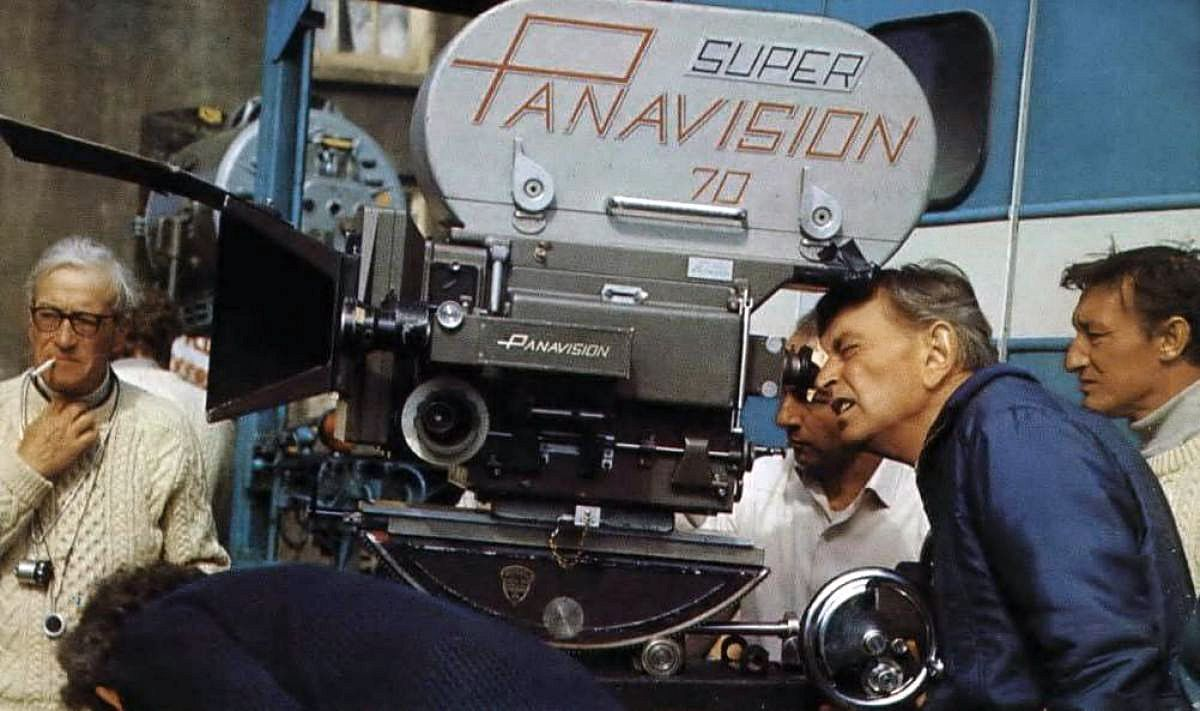 Lean checks camera angle through the viewfinder while Young (left) scans the scene. Shooting in 65mm Super Panavision 70 called for the cinematographer to light to deep stops in order to maintain any workable depth of field.