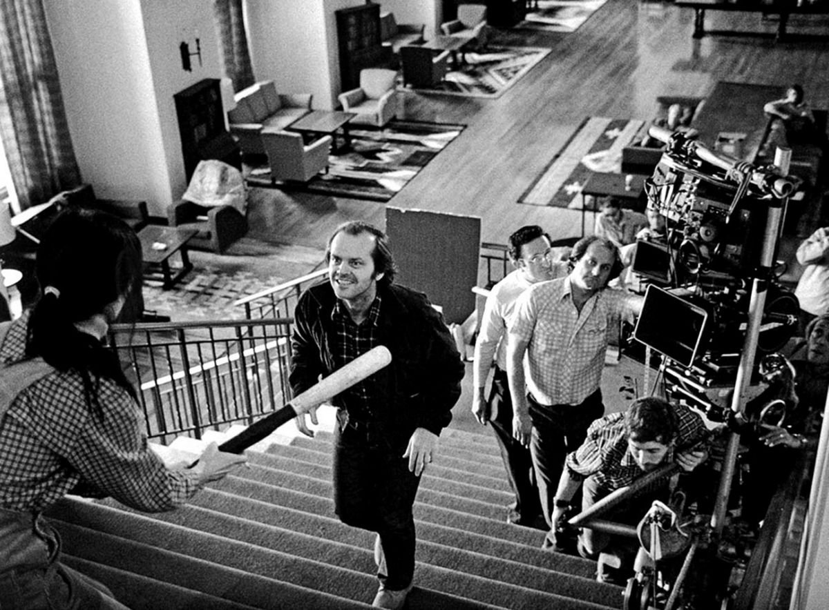 Jack (Jack Nicholson) advances on Wendy (Shelly Duvall) as the cameras trail up the staircase on a custom rig. To the right of Nicholson is 1st AC and second-unit cinematographer Douglas Milsome, who would later photograph Kubrick's Full Metal Jacket (1987) and become an active member of both the BSC and ASC.