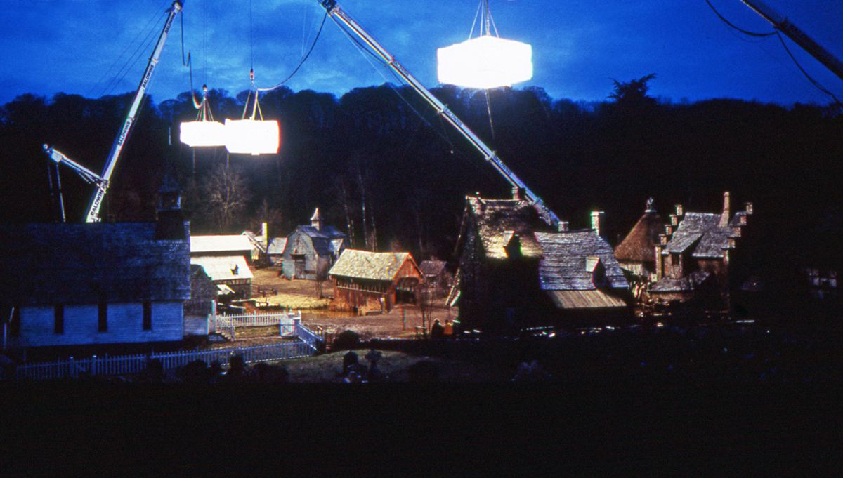 Suspended from heavy-duty construction cranes, three giant softboxes illuminate Sleepy Hollow's town center, a highly detailed exterior set built on location in Marlow, England.