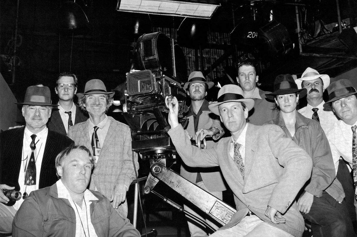 In this fun behind-the-scenes portrait by unit photographer Merrick Morton, the crew of L.A. Confidential really gets into the film noir mood. Featured are Spinotti and Hanson (both wearing fedoras, left of the camera).