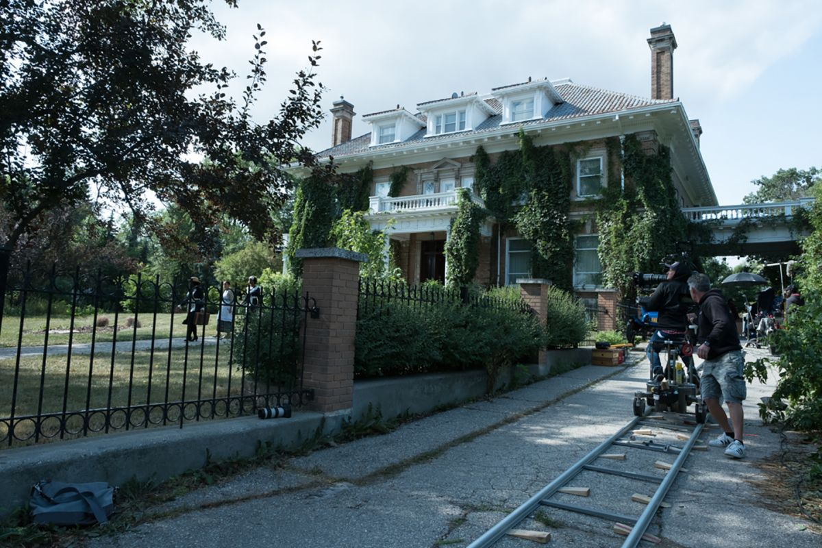 Cast and crew capture a scene outside of Winnipeg's historic Gordon House.