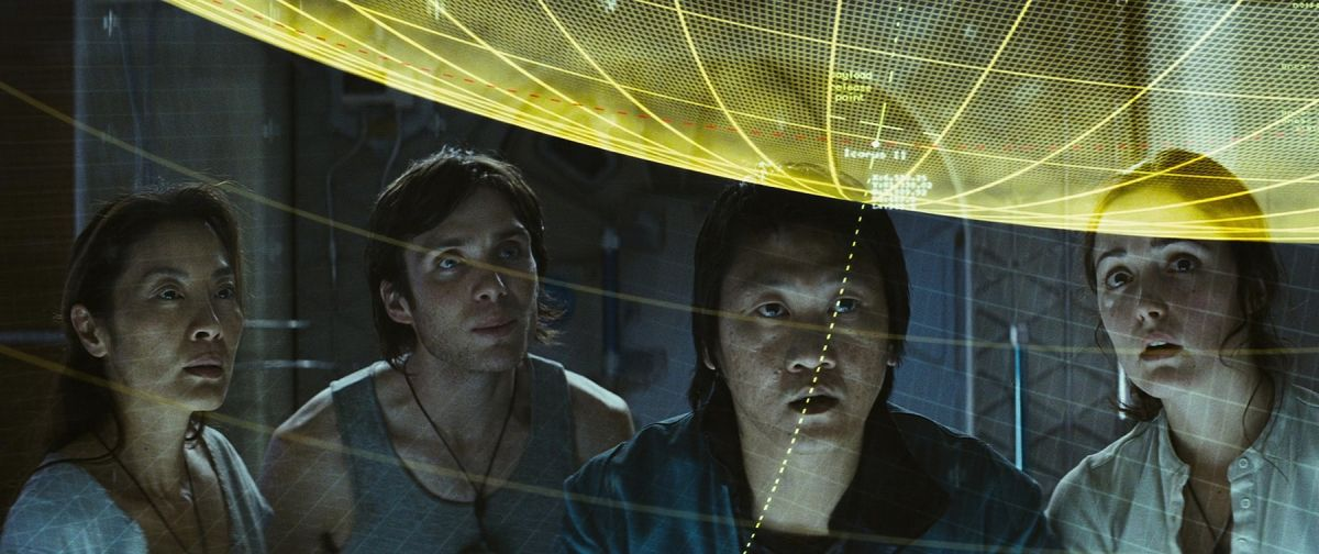 The Icarus II crew examines a computer simulation of their risky mission. Küchler purposefully employed darkness on certain interiors to accentuate the brightness of others to establish deeper contrasts.